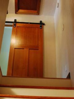upstairs barrel door to bathroom