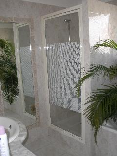 Bathroom with both tub and separate shower. (Small toilet is separate off the entry.)