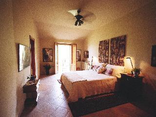 Sunny bedroom with balcony overlooking park