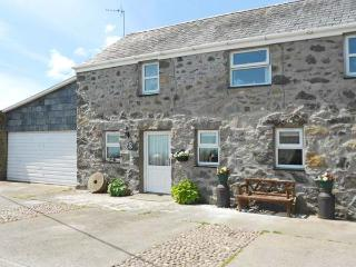 TAN Y FRON, semi-detached cottage, distant sea views, off road parking, garden,