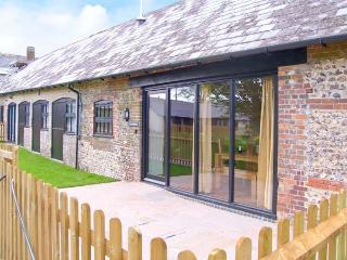 THE OLD STABLES, pet-friendly single-storey luxury cottage, en-suite, garden, ga