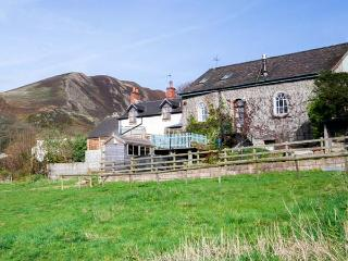 THE OLD CHAPEL, 19th century, semi-detached cottage, woodburning stove, private hot tub, in Church Stretton, Ref 30035
