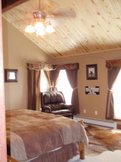 Upstairs Master Bedroom, also known as the Ranching Room. Has private bath with tub, shower and view