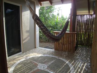 Private patio with hammock and comfy outdoor deck chairs available
