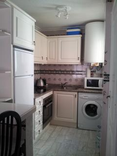 Kitchen with new fridge freezer; cermic hob and fitted oven, automatic washer, pot drainer over sink