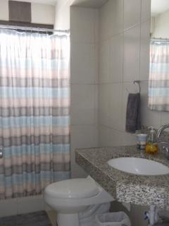 Second bathroom with shower, sink, toilet and granite counter