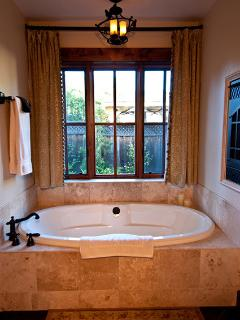This soaking tub has a fireplace and surround sound.