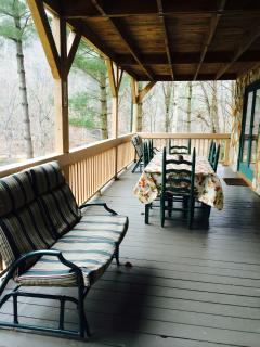 Covered front porch overlooks the river