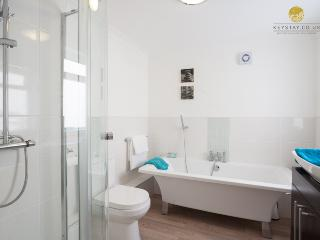 Luxury family bathroom with double ended bath with separate shower cubicle.