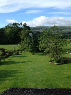 View of garden and hills from master bedroom - lie in bed and watch the tree tops sway