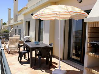 The large veranda has table & chairs, BBQ and sun loungers