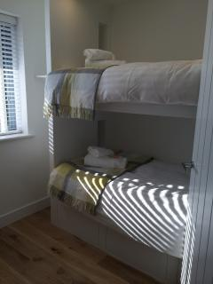 Bunk Bedroom - full size single mattresses in custom made bunk with storage