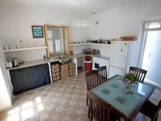 Kitchen upstairs, opens onto the front and rear roof terraces. Has 10 seater table.