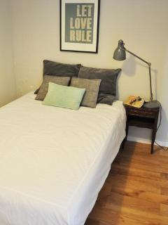 Bedroom with large bed for two - holds a large closet for putting stuff away