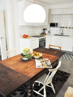 The dinner table is the center of the apartment - for social vacations
