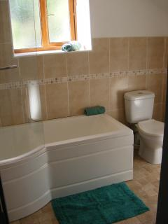 Relax in the newly fitted bathroom with bath and shower