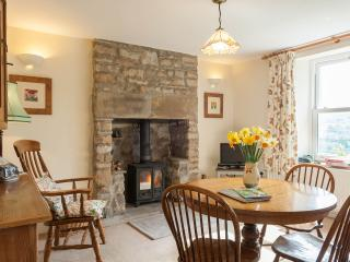 The dining room; bright, light and with lovely views of the garden.