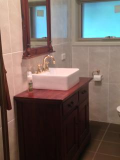 The private, rustic, brand new bathroom.