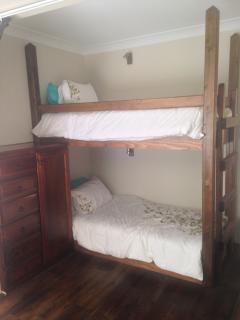 The children's bunk beds.