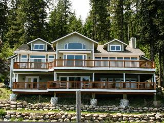 Grand waterfront home w/ decks offering lake views plus boat slip & nearby dock