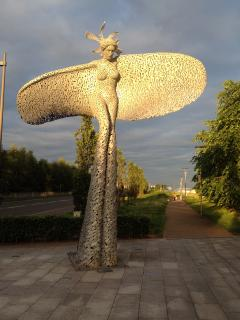'RISE' -a sculpture by Andy Scott at the front of the apartment complex