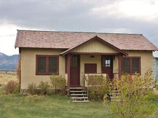 The guest cabin has two bedrooms each with one double bed and two baths.