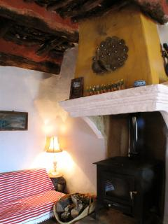 Cozy corner in living room, we provide a basquet of wood with our compliments