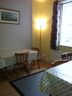 Cosy dining room seats eight.