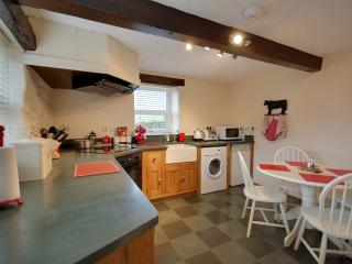 Well equiped Byre Dining Kitchen with slate worktops and belfast sink