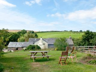 View behind Mill Cottage, seating & BBQ area.