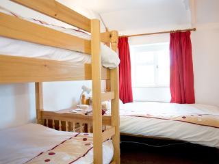 Upstairs bedroom with bunk beds, a single bed and lovely views.