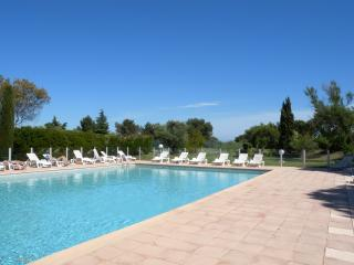 The large and clean swimmingpool size 15 m x 7 m, sunbeds and facilities like shower and bathrooms.