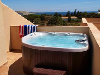 Enjoy watching the sun set in the private hot tub on roof terrace with sea views and six sun beds