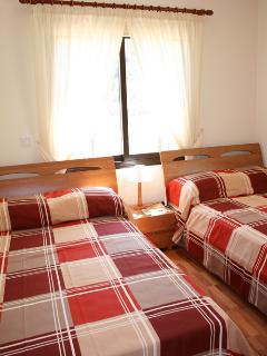 The second bedroom with extra-large single beds