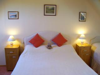 The sunny bedroom has a king-size double bed and a single bed.