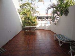 A huge terrace overlooking the community pool.  All day sun in the summer months