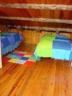 Rustic Attic Room (2 conjoined rooms like this each with 2 single beds)