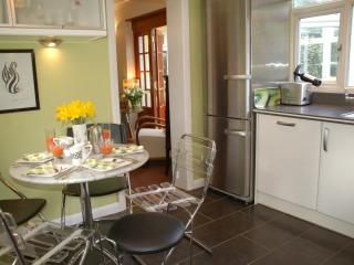 Bright dual aspect Kitchen with breakfast area & views of the garden