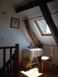 The bedroom writing desk at the top of the staircase has fabulous natural light streaming in