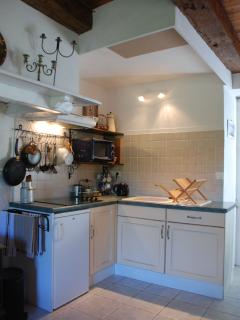 Kitchen includes hotplates,rangehood, microwave, fridge and is equipped with cookware and utensils