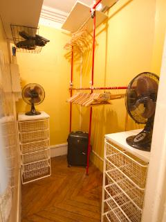A large, walk-in closet is located off of the entryway for ample storage.