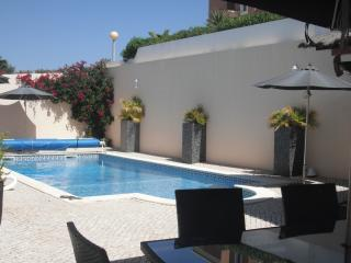 Heated sunny pool, including outside dining for 8, sunbeds and umbrellas