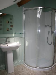 The huge shower in bathroom.