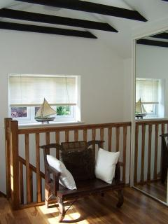 The Boathouse - open-tread stairs lead into first-floor bedroom