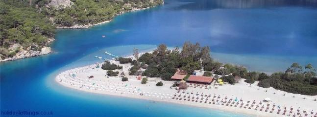 Olu Deniz Beach with beautiful lagoon behind, ideal for swimming and snorkeling.