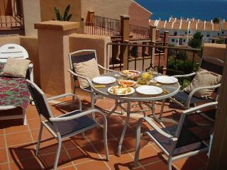 Lovely balcony with dining set to enjoy a nice meal in a sunny day