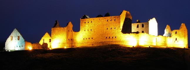 Ruthven Barracks (adjacent) is floodlit at night
