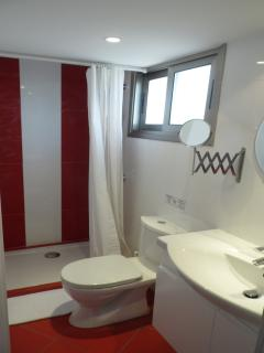 Ensuite Bathroom of Suite with Fire Place and Sunset/City View