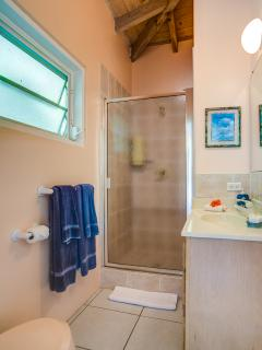 One of the four similar guest bathrooms.