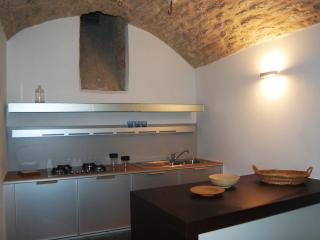 The new kitchen has up-to-date appliances in a clean but ancient space